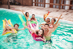 Couples swimming in pool and having fun Royalty Free Stock Photography