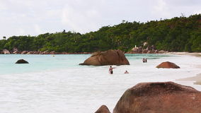 Couples swimming in the sea on Anse Lazio, Seychelles stock video footage