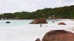 Couples swimming in the sea on Anse Lazio, Seychelles. Couples swimming in the Indian Ocean on Anse Lazio, Seychelles stock video footage