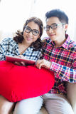 Couples with tablet Royalty Free Stock Photo
