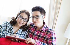 Couples with tablet Stock Images