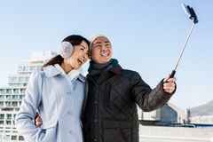 Couples taking funny pictures using smartphone Stock Photography
