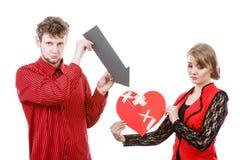 Couples tenant des symboles d'amour Images libres de droits