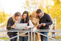 Couples with tourist map in autumn park Stock Images