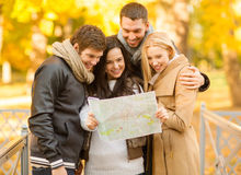 Couples with tourist map in autumn park Royalty Free Stock Photo