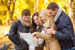 Couples with tourist map in autumn park Royalty Free Stock Images