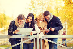 Couples with tourist map in autumn park Stock Photo