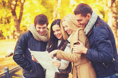 Couples with tourist map in autumn park Royalty Free Stock Image