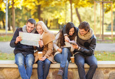 Couples with tourist map in autumn park Stock Photos