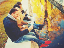 Couples with tourist map in autumn park Stock Image