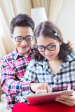 Couples using tablet stock images