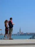 Couples at Venice. Couples standing on the bridge at San Giorgio Maggiore Venice royalty free stock photos