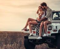 Couples voyageant en voiture Photos libres de droits