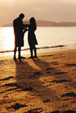 Couples walking to the sunset Royalty Free Stock Image