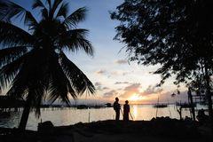 A couples watching the sunset near the lake, Royalty Free Stock Images