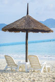 Couples of white chairs on traveling destination sea beach Royalty Free Stock Image