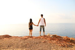 Couples who takes the hand. Young couple holding hands by the sea stock photos