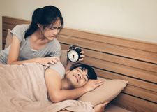 Couples, women motivating men who are asleep, made with a desk c stock image