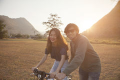Couples of younger asian man and woman practice to riding bicycl Stock Photos