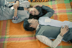 Couples of younger asian man and woman relaxing emotion lying in Stock Images