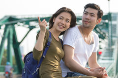 Couples of younger asian man and woman relaxing with happy face Stock Photos