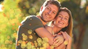 Couplez dans le jardin entouré par une animation des bulles oranges clips vidéos
