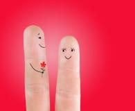 Couplez le concept avec la fleur, peinte aux doigts Images libres de droits