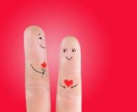 Couplez le concept avec la fleur, peinte aux doigts Image stock