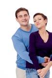 Couplez les paires dans étreindre d'amour d'isolement sur le blanc Images libres de droits