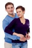 Couplez les paires dans étreindre d'amour d'isolement sur le blanc Images stock