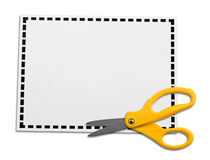Coupon. Yellow scissors laying on a blank coupon isolated on white background. Perfect for advertisement,commercial etc royalty free stock photo