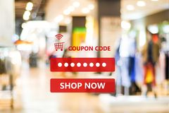Coupon code on blur store background, web banner shopping on lin. E promotion, on line shopping, digital marketing, business and technology concept royalty free stock photography