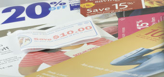 Coupon Collage. A collage of coupons illustrating modern consumerist shopping lure stock photography