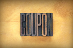 Coupon Letterpress. The word COUPON written in vintage letterpress type Royalty Free Stock Photo