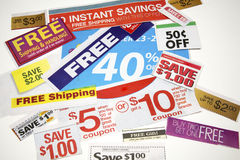Coupon Offers. Collage of coupon offers clipped from advertisements Stock Photo
