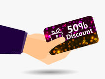 Coupon for a 50-percent discount in the hand. Gift card with bright sparks. Vector. Illustration Stock Images