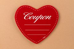Coupon. Red Heart of Felt with lettering in german language - Coupon Royalty Free Stock Photos