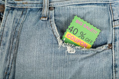 Coupon. Voucher paper inside pocket  jean Royalty Free Stock Photo