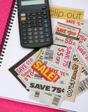 Coupons and caculator on notebook. Some coupons and caculater on notebook Stock Image