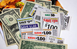 Coupons and dollars. Some coupons and moneys on white paper Royalty Free Stock Image