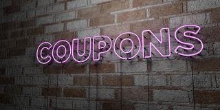 COUPONS - Glowing Neon Sign on stonework wall - 3D rendered royalty free stock illustration Stock Photo