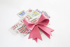 Coupons offer with bowknot background. Coupons cut from newspaper background Stock Photos