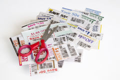 Coupons and scissors. A cutting coupons and scissors background Royalty Free Stock Photo