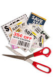 Coupons With Scissors XXXL. Close up or macro shot of many coupons with a pair of red handled scissors and isolated on white with shadow Stock Images