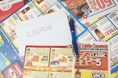 Coupons from stores and restaurants filling frame Royalty Free Stock Photo
