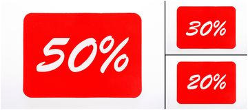 Coupons with 50, 30 und 20 percent discount. In red Stock Photos