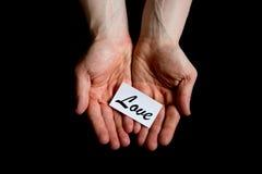 Coups de main, amour de offre Image stock