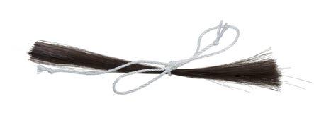 Coupure de cheveux attachée avec de la ficelle Photo libre de droits
