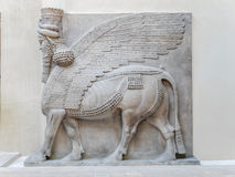 Cour Khorsabad Relief, Assyria - Louvre Museum. PARIS, FRANCE - AUGUST 28 2013: Relief in Cour Khorsabad courtyard - part of Ancient Mesopotamian history Stock Images