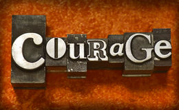 Courage. The word Courage photographed using vintage type characters on a gold fabric background. See my portfolio for more vintage type images royalty free stock images